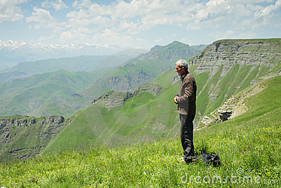Man praying in mountains