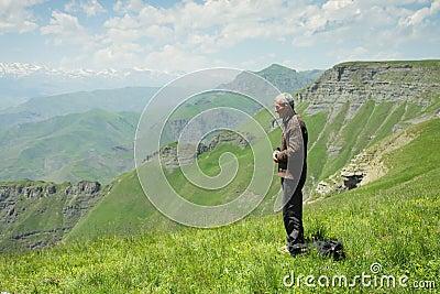 Man praying in mountains