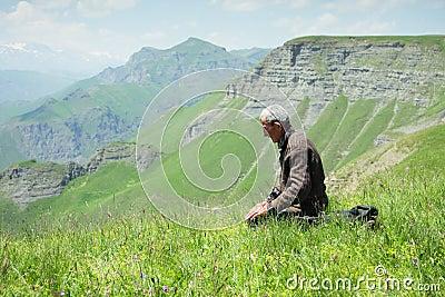 Man praying in mountains closeup