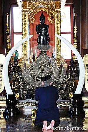 Man praying in temple