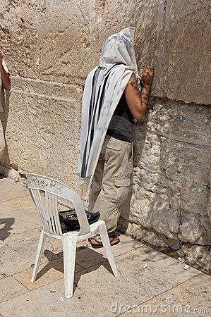 Man praying at western wall Editorial Image