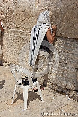Man praying at western wall Editorial Image