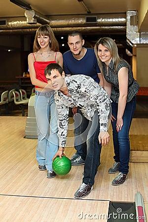 Man prepares throw ball in bowling club