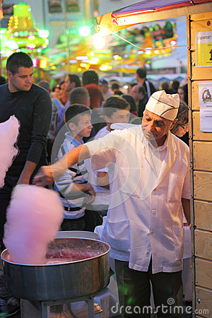 Man preparing cotton candy Editorial Photography