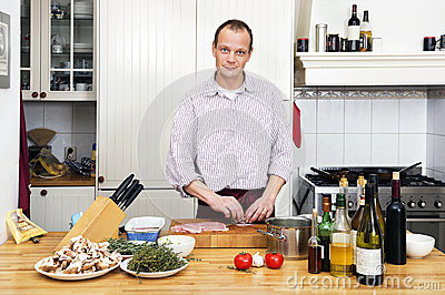 Man Preparing Meat At Kitchen Counter