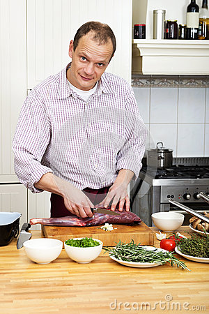 Man Preparing Meat At Kitchen Counter