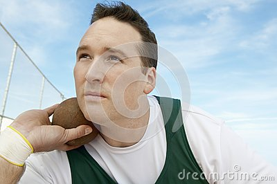 Man Preparing To Toss Shot Put