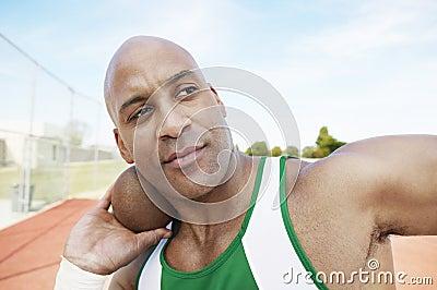 Man Preparing To Toss Shot Put