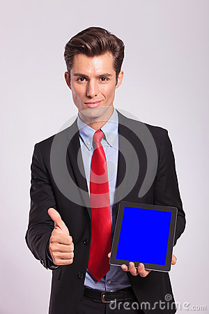 Man presentig tablet and showing thumb up