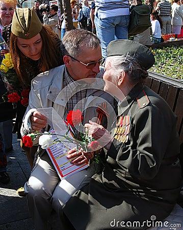 A man presents a photo to a war veteran Editorial Stock Photo
