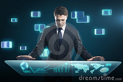 Man pressing high tech type of modern buttons