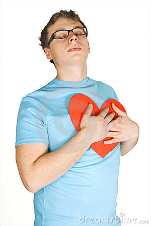 Man pressing to bosom red paper heart