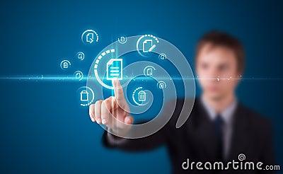 Man pressing virtual messaging type of icons