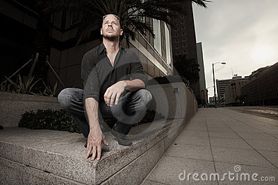 Man pretending to be a gargoyle
