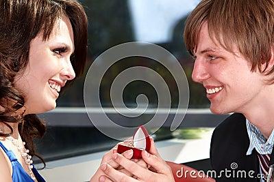 Man propose marriage to beautiful girl.