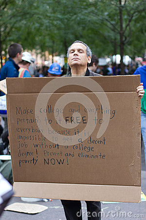 Man with protest sign at Occupy Wall Street Editorial Image