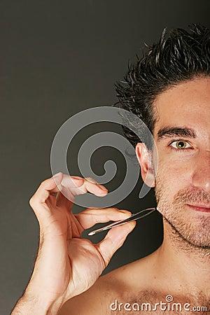 Man pulling his beard