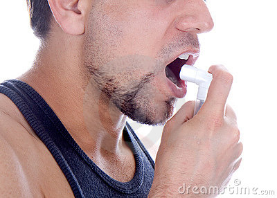 Man with pump in his mouth, against asthma