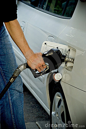 Man pumping gas into car