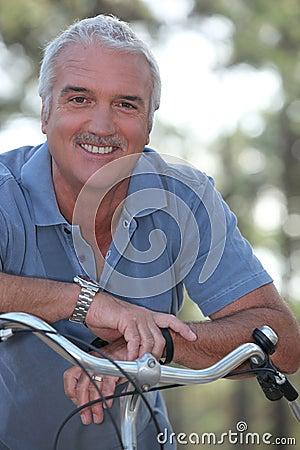 Man with push bike