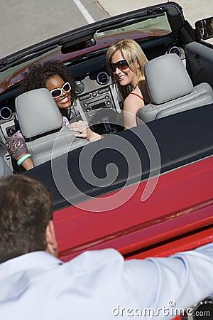 Man Pushing Car Driven By Women