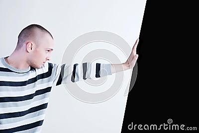 Man pushing wall