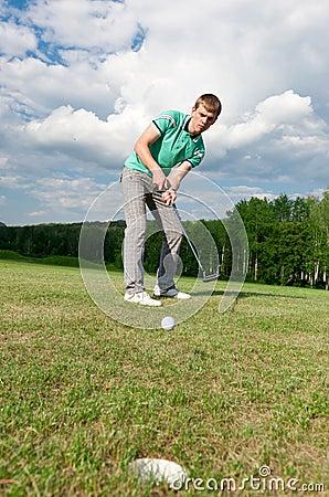 Man putting ball inside short putt