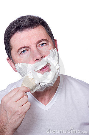 Man putting beard foam
