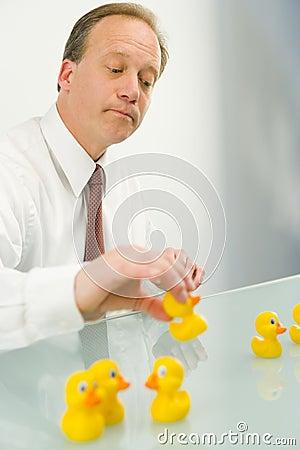 Man putting ducks in a row