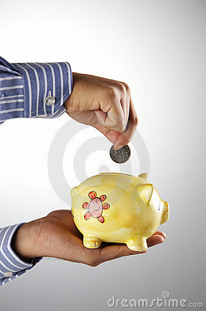 Man putting money into piggy bank