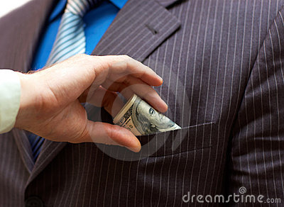 Man putting money into suit pocket