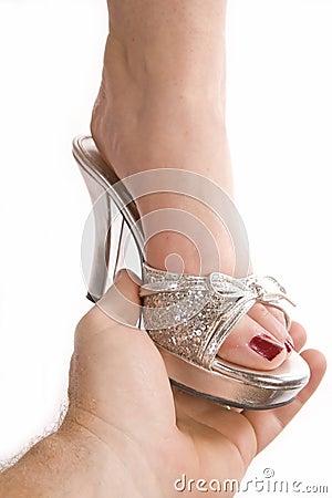 Free Man Putting Shoe On Woman Royalty Free Stock Image - 11653556