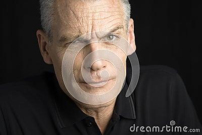 Man with raised eyebrow