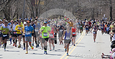 Man raises fist in triumph at Boston Marathon 2014 Editorial Photo
