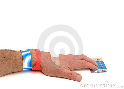 Man reaching for pills