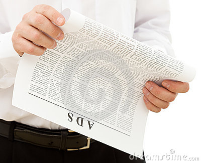 Man reading ads from the paper