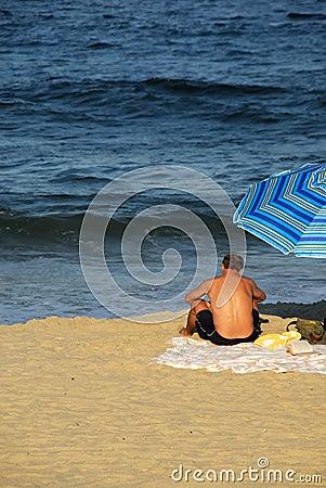 Man Reading at the Beach