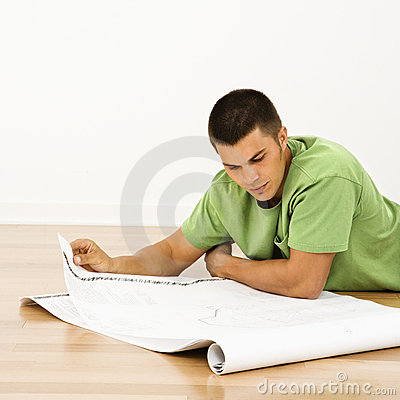 Man reading blueprints.