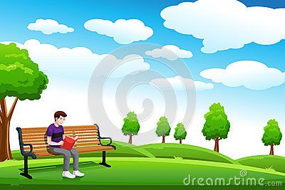 Man reading a book on the bench