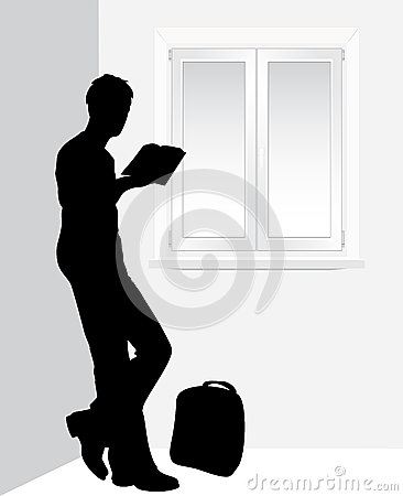 Man reading a book near the window