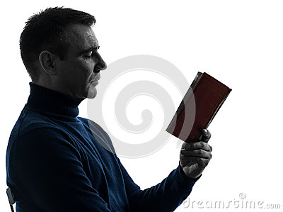 Man reading book silhouette portrait