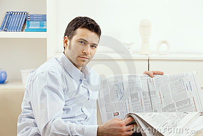 Man reading business news