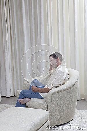 Man Reading Digital Tablet