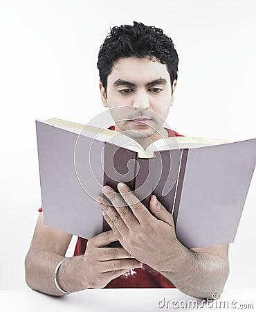 Man reading an encyclopedia