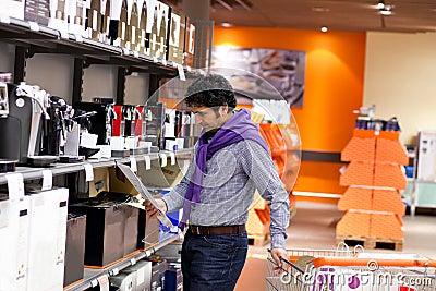 Man reading instruction for coffey machine