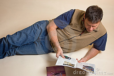Man reading magazines