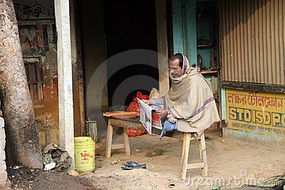 Man reading the newspaper Editorial Stock Image