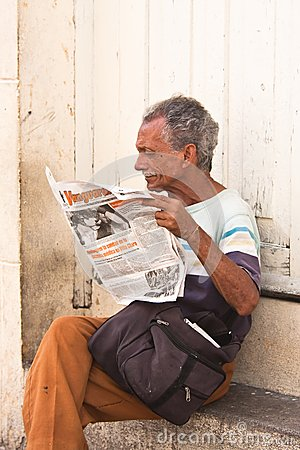 A man reading a newspaper  Cuba Editorial Stock Photo