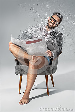 Free Man Reading Newspaper On Gray Background Royalty Free Stock Photography - 55849067