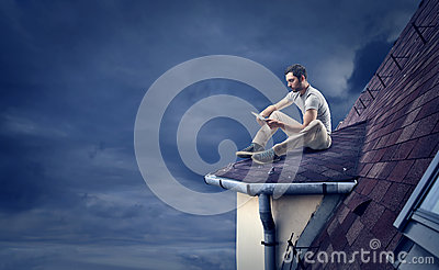 Man reading on a roof